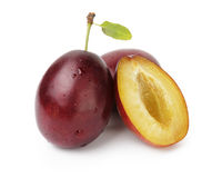 Three ripe plums Royalty Free Stock Images