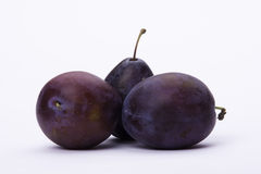 Three ripe plums on white background Royalty Free Stock Image