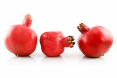 Three Ripe Pomegranates Fruits in Raw Isolated Stock Photo