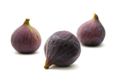 Three ripe purple fig fruits. Isolated on white background royalty free stock image