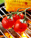 Cherry tomatoes grilling over a fire Royalty Free Stock Image