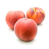 Three ripe red peaches Royalty Free Stock Photography