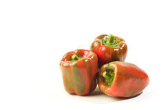 Three ripe red peppers. Royalty Free Stock Photography