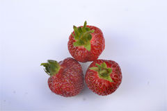 Three ripe red strawberries on a white background, Royalty Free Stock Photos