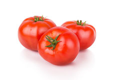 Three ripe red tomatoes Stock Images