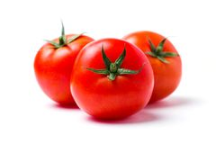 Three ripe red tomatoes on white isolate background, closeup stock photography