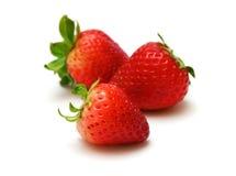 Three ripe strawberries. Three delicious ripe strawberries on a white background Stock Image