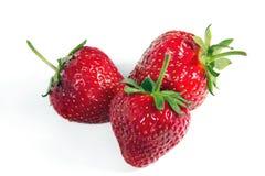 Three ripe strawberries on a white Royalty Free Stock Photo