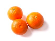 Three ripe tangerine on a white background. Stock Photos