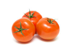 Three ripe tomatoes closeup isolated on white background Stock Photography