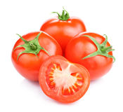 Three Ripe Tomatoes and its half  Stock Photography