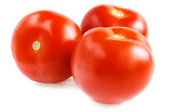 Three ripe tomatoes on a white background. Royalty Free Stock Image