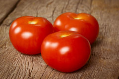 Three ripe tomatoes Stock Image