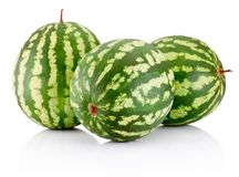 Three ripe watermelons berry isolated on white background. Three ripe watermelons berry isolated on a white background royalty free stock photography