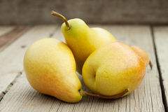 Three ripe yellow pears Stock Photography