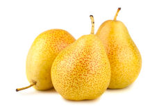 Three ripe yellow pears Stock Images