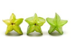 Three ripening star fruits Stock Image