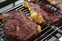 Three roast steak on electrical brazier Royalty Free Stock Photo