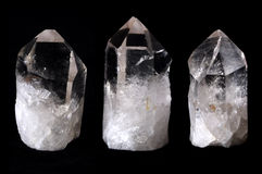 Three rock quartz crystals. Three transparent quartz crystals over black Royalty Free Stock Photography