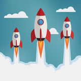 Three rockets in the clouds. Royalty Free Stock Photography