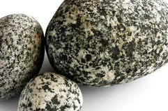 Three Rocks. Three speckled rocks from Alaska Royalty Free Stock Photos