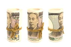 Three Roll Up Of Money Yen Banknote On White Background. Business And Finance Concepts Stock Image