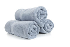 Three rolled gray towels on white Stock Image