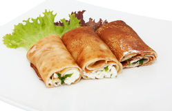 Three rolled pancakes with cheese Stock Images