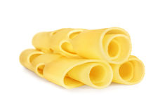 Three rolled slices of Swiss cheese. Stock Images