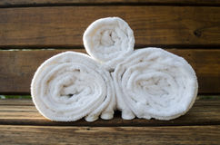 Three Rolled Towels on a Bench Stock Image