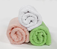 Three rolled towels, isolated on white background Stock Image