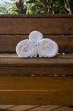 Three Rolled Towles on a Bench Vertical Royalty Free Stock Photo