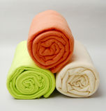 Three rolled up towels Stock Photos