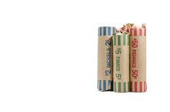 Three rolls of money change wrapped in container Royalty Free Stock Image
