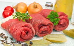 Three rolls of raw beef Royalty Free Stock Photography