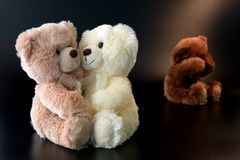 Three romantic teddy bears. Three  romantic teddy bears, isolated on black background Royalty Free Stock Photography