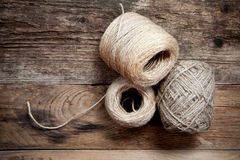 Three rope coils on old wooden background Royalty Free Stock Image