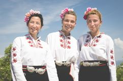 Three Rose oil Festival girls in traditional costume stock images