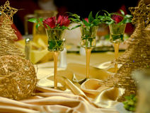 Three roses as a table decoration. Royalty Free Stock Photo