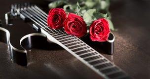 Three roses on black guitar