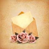 Three roses in front of an old envelope with a let Stock Image