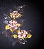 Three roses in pink gold. With gold leaves on a black textured background. Pink gold. Design with roses Royalty Free Stock Images
