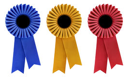 Three Rosettes. Blue, gold and red rosettes, with copy space, isolated on white stock illustration