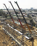 Three Rough Terrain Cranes are working on construction site. Royalty Free Stock Images