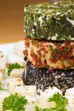 Three round cheese with herbs on a plate Royalty Free Stock Photos
