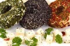 Three round cheese with herbs on a plate Royalty Free Stock Photography