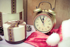 Three round gift boxes with alarm clock and Santa Royalty Free Stock Photography