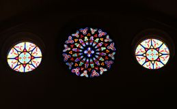 Three round stained glass windows. With colors, structures and patterns in a church at the isle of Mallorca (Majorca), Spain Royalty Free Stock Photography