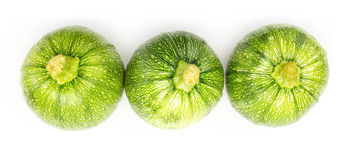 Three round zucchinis in a row Stock Photography
