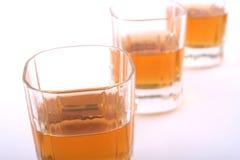 Three in a row. Three shots of bourbon fading away - high key Stock Photo